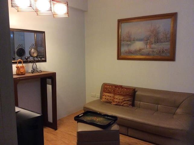 A cozy 1BR unit @ Scandia Suites - Sta Rosa - Pis