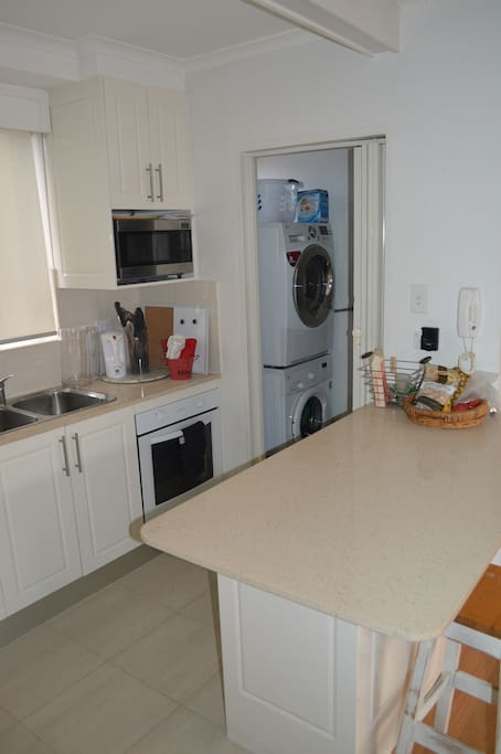 Kitchen with internal laundry adjacent. Large new washer and dryer