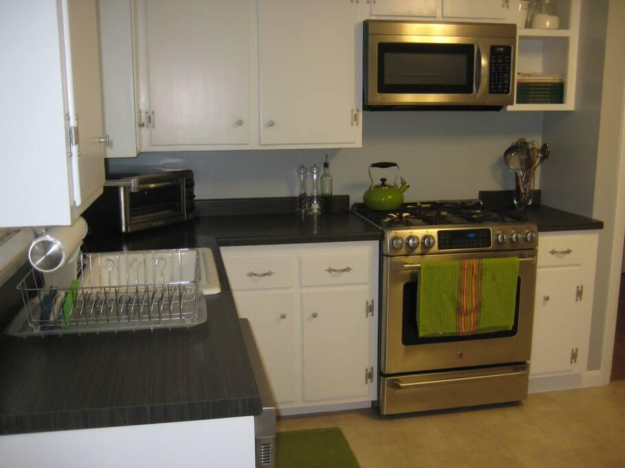 A bright kitchen with gas range.