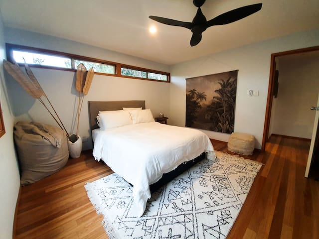 Master bedroom, fresh linen sheets and bedding.