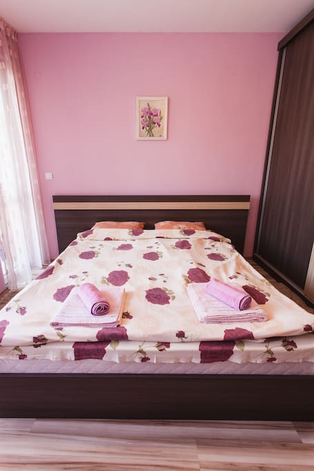 The bedroom with comfortable king- size bed
