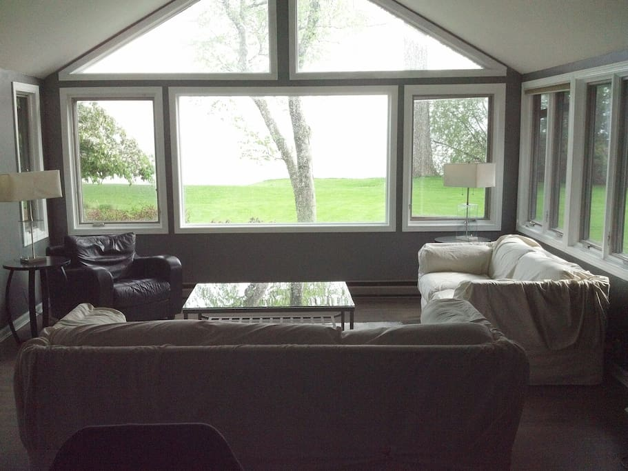 Family room arranged for summer with view of lake.  Relax watching Pelicans, Eagles and Ducks.