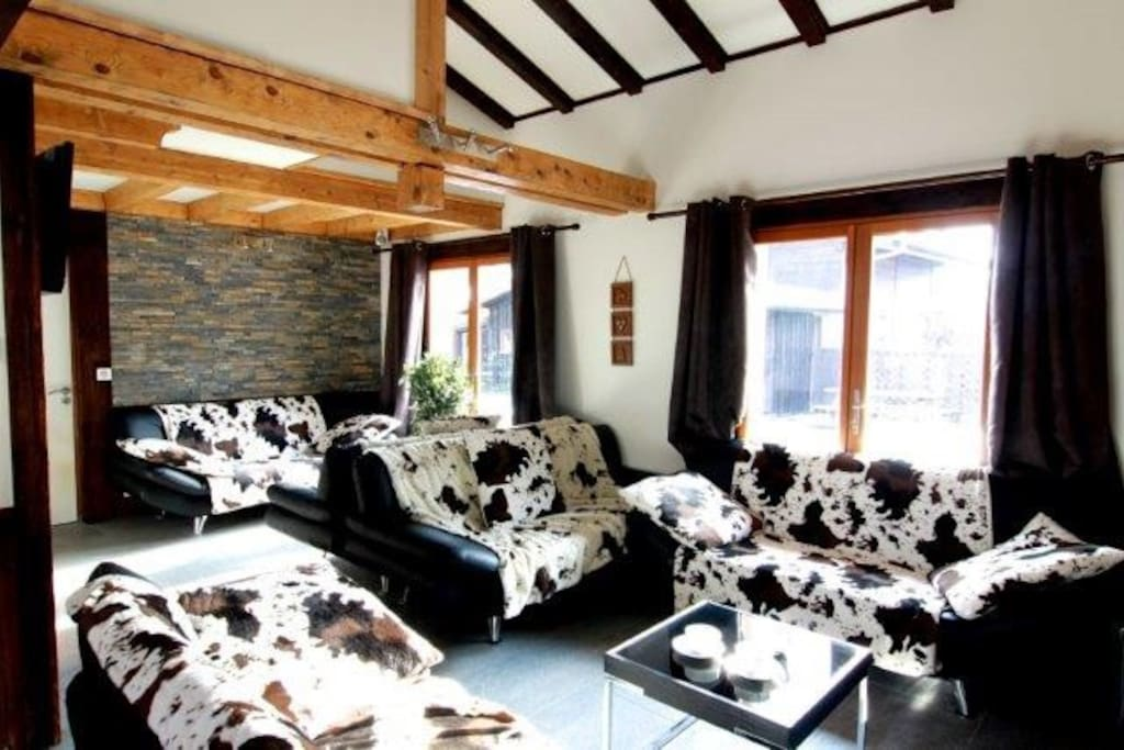 Lounge area with 5 sofas and log fire