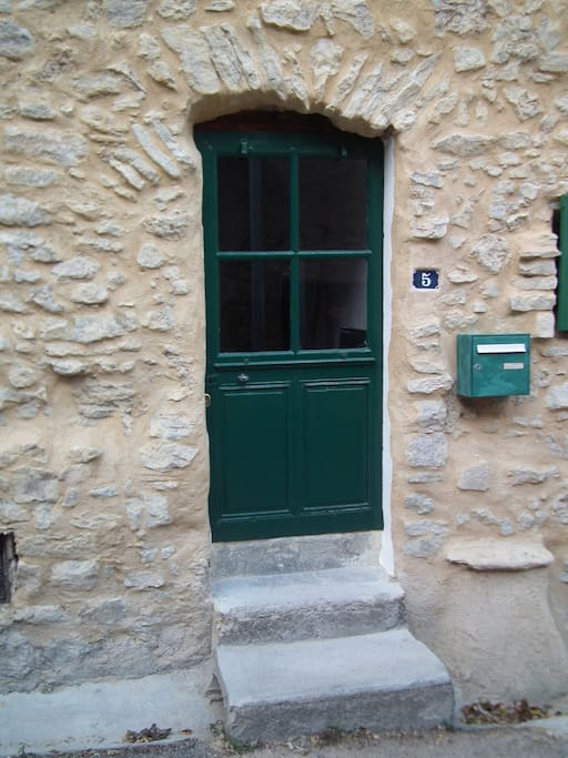 Front door of the house shows the archway from 1120.
