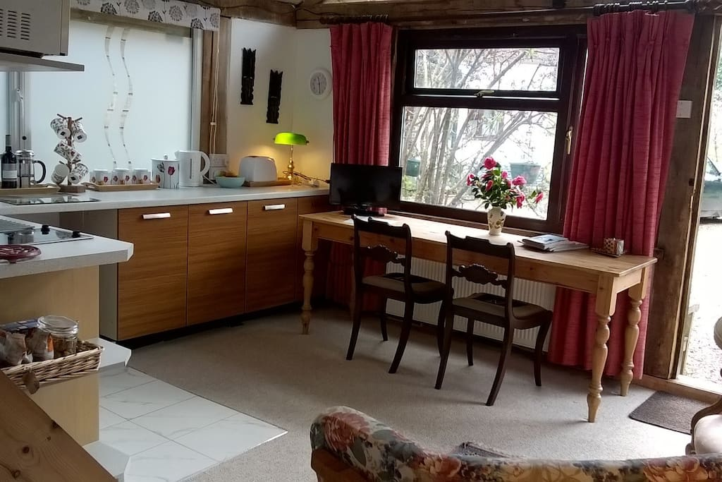 The work / dining table beneath the window in the annexe.