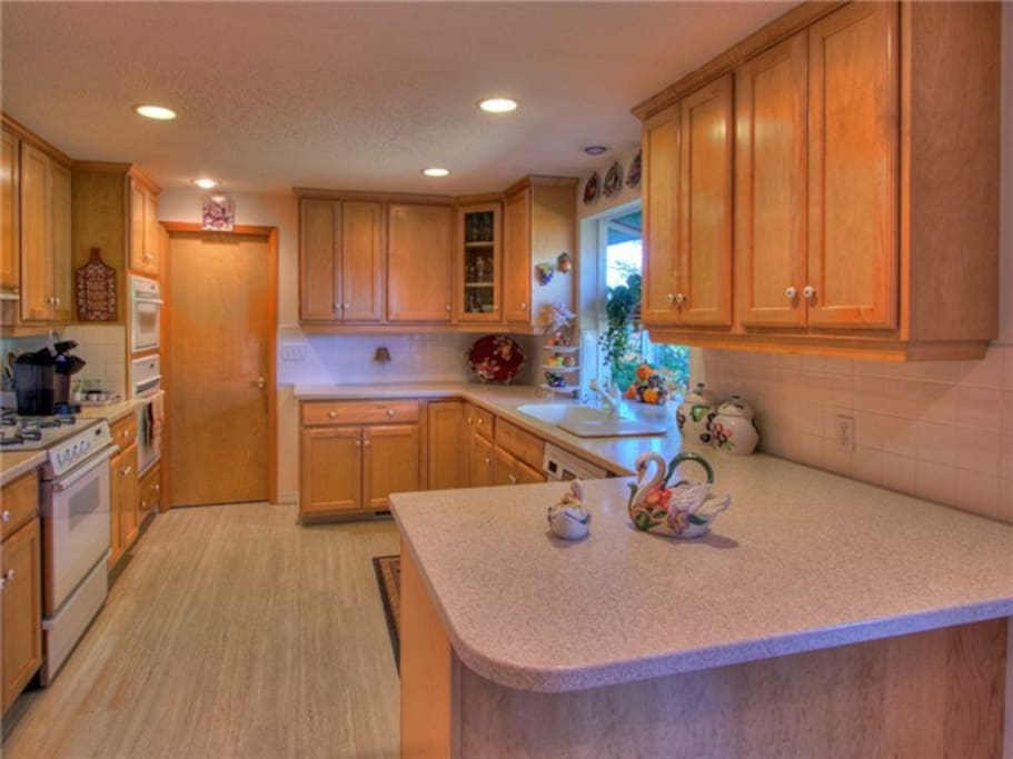 Big open kitchen with easy laundry and bath nearby