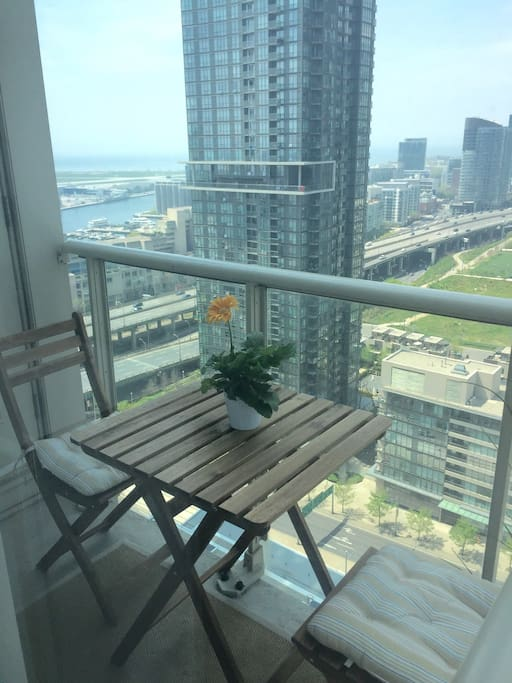 Balcony with bistro table and lake view