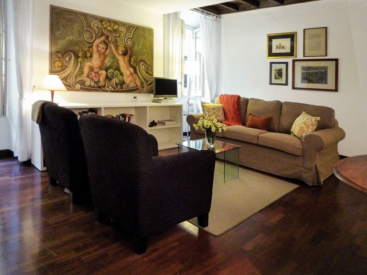 Welcoming Bellina apartment is tastefully appointed with sofa bed and two comfortable armchairs.