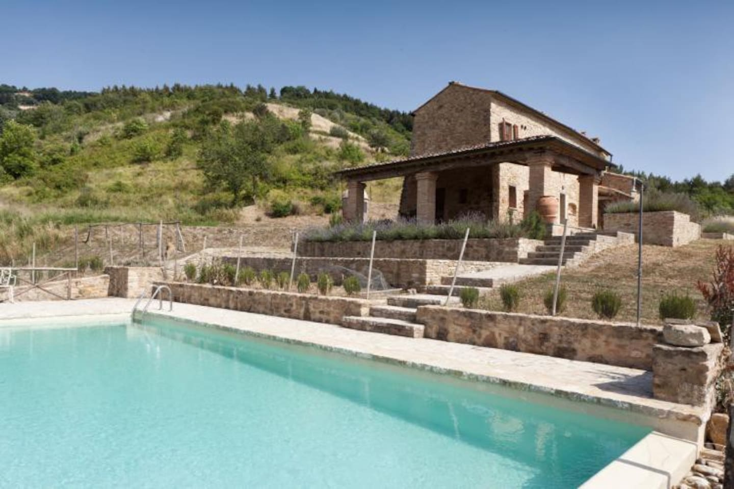 Villa Fraggina exterior with swimming pool and terraced garden
