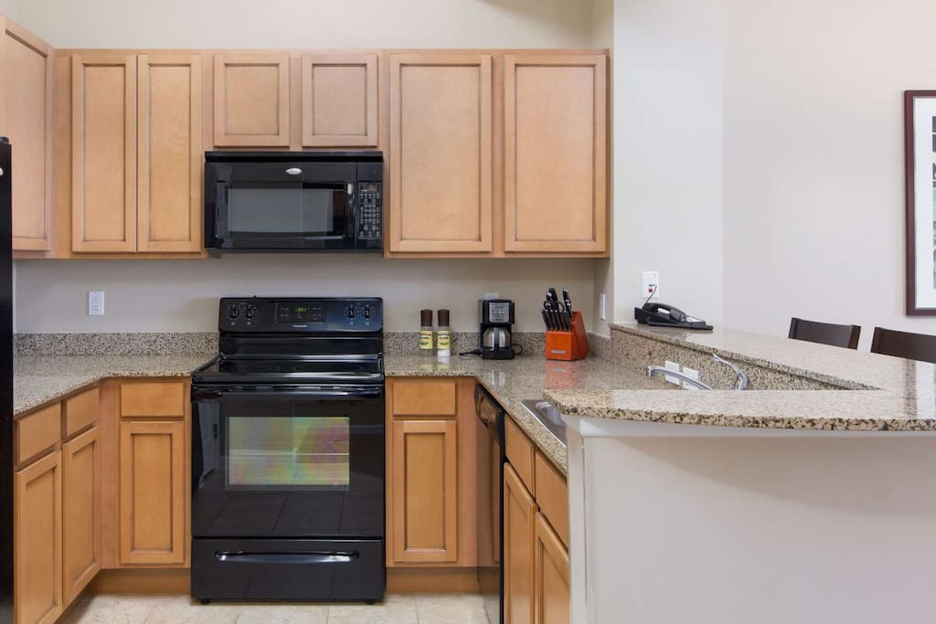 This beautiful kitchen with granite counters is fully stocked for all your needs