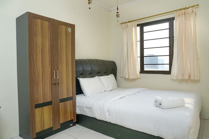 Clean and Homey 1BR at Puri Garden Apartment