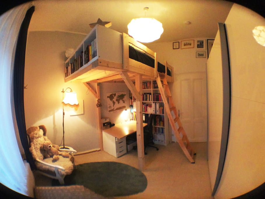 Relax in a comfortable loft bed, with a second workplace below.