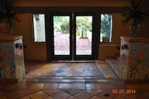 Tiled and secured entry has Mediterranean ambience.