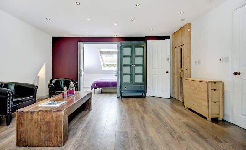 1 bedroom & living room loft flat in family house