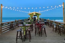 The Tiki Bar is just across the street and open for lunch, dinner or just cocktails. This is the only place on the island you eat and drink above the beach, and there is a convenient entryway to the sand as well!