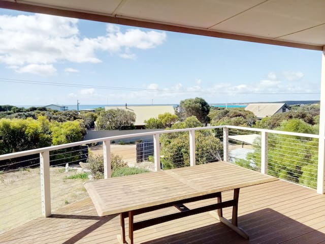 Upper level deck with expansive ocean views.