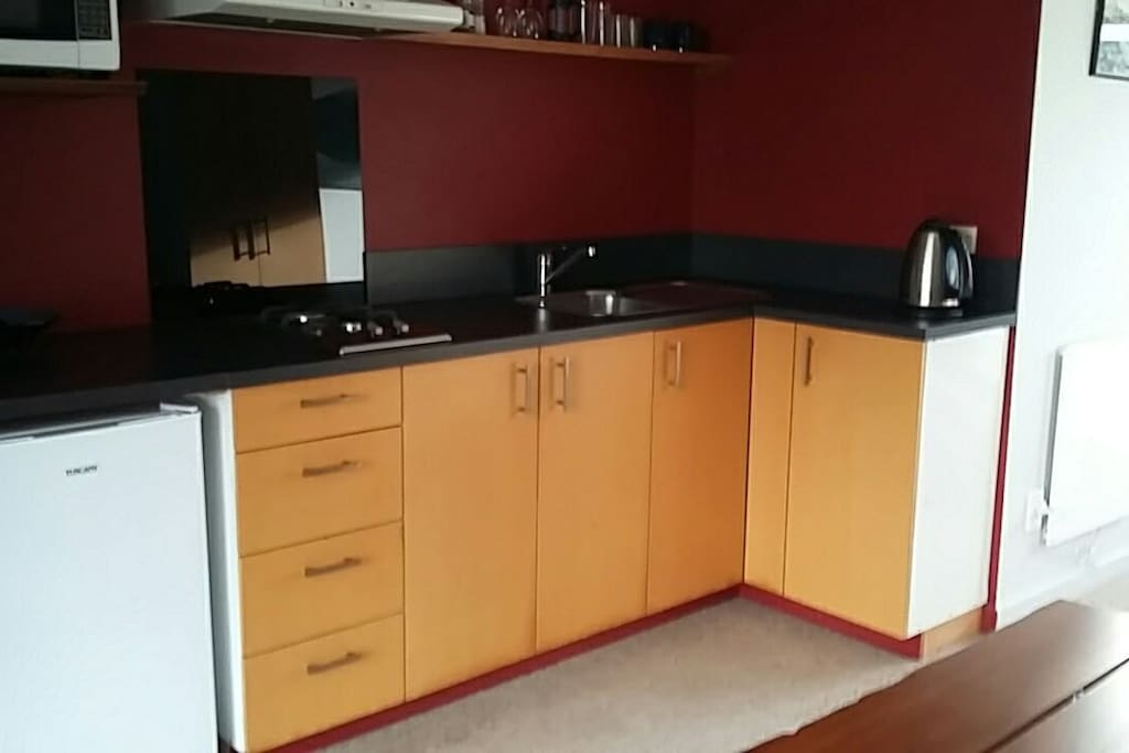 A basic kitchen with brand new 2 burner gas hob for when you don't want to eat out.