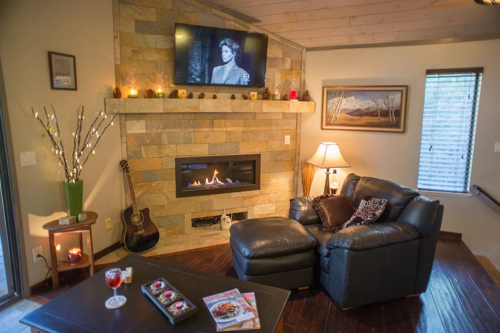 "Leather recliners, smart 50"" flat screen TV and Bose sound bar. Wi-Fi and board games.  Gas reflective enclosed fireplace."
