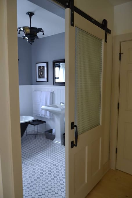 Barn door to the private bathroom