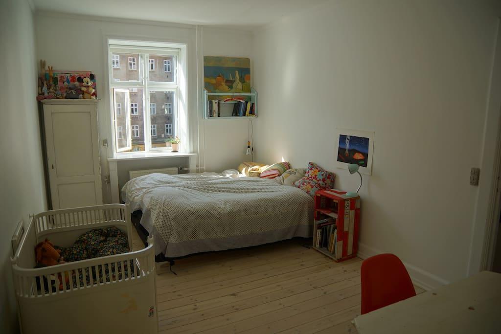 Large bedroom, turning towards the yard.