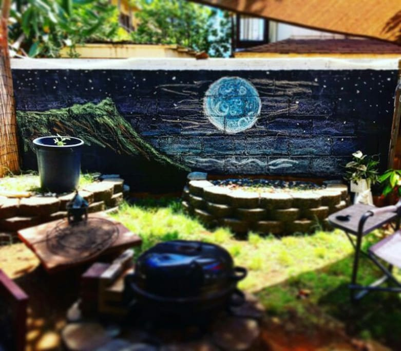 Back yard wall art and BBQ fire pit where night dinners often begin and good times roll!
