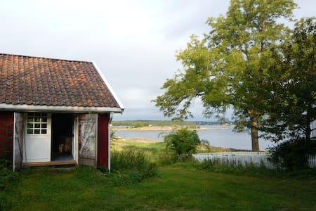 House on an idyllic island farm - Blockhütte