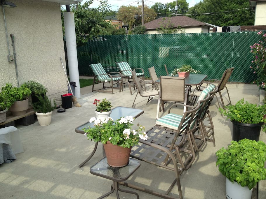 A back patio allows for plenty of comfortable seating in the backyard during the hot summer days or around a fire in the evening.