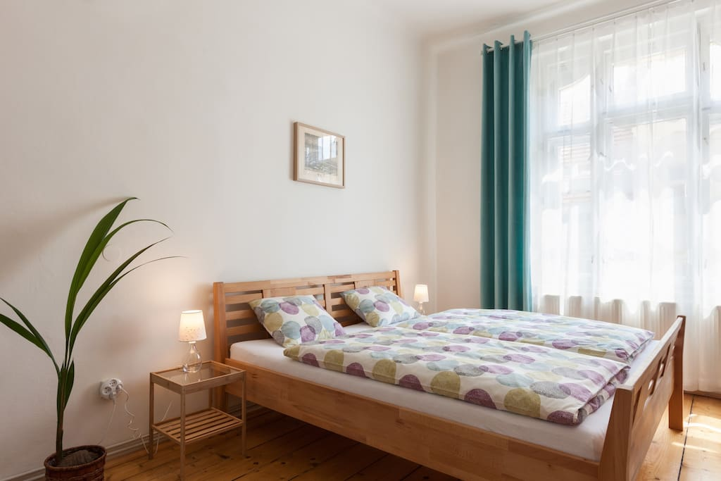Spacious bedroom with clean bedclothes for every guest.