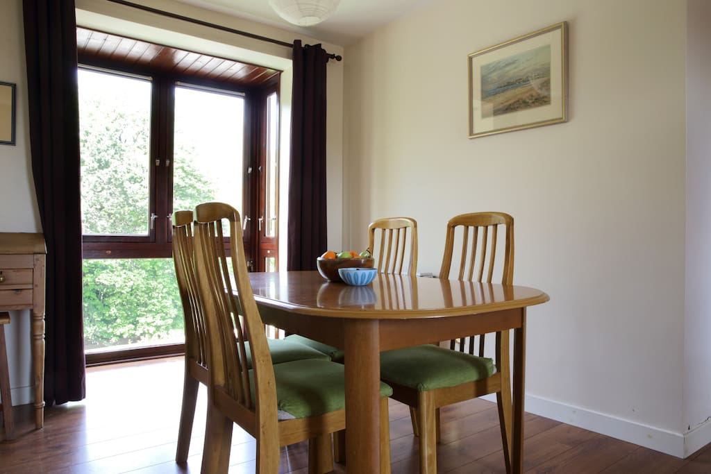 The dining table extends to seat six.