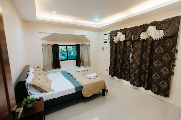 The master bedroom features a queen-sized bed and it's own bathroom.