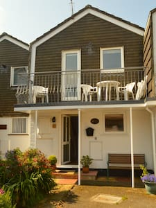 Waterside Cottage located in East Cowes on the Isle of Wight adjacent to the chain ferry linking directly with the sailing town of Cowes.  Balcony views over the River Medina and The Solent perfect for watching commercial and pleasure craft