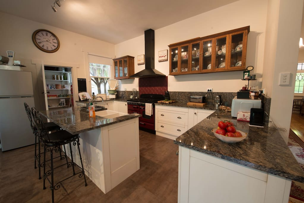 Gourmet large open Kitchen/dining with Falcon stove, granite benchtops and