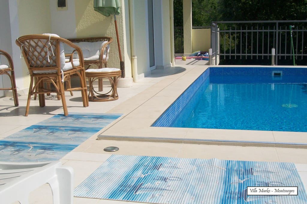 Anti-slip mats are placed by the pool