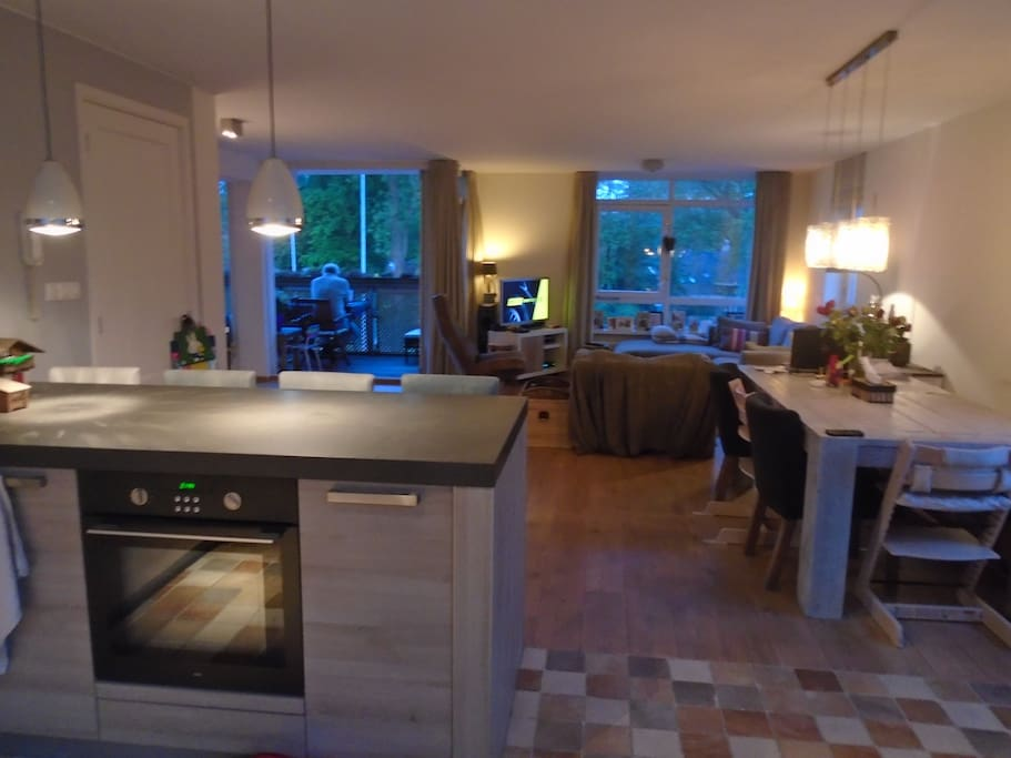 View from the open kitchen to the living room with dining table