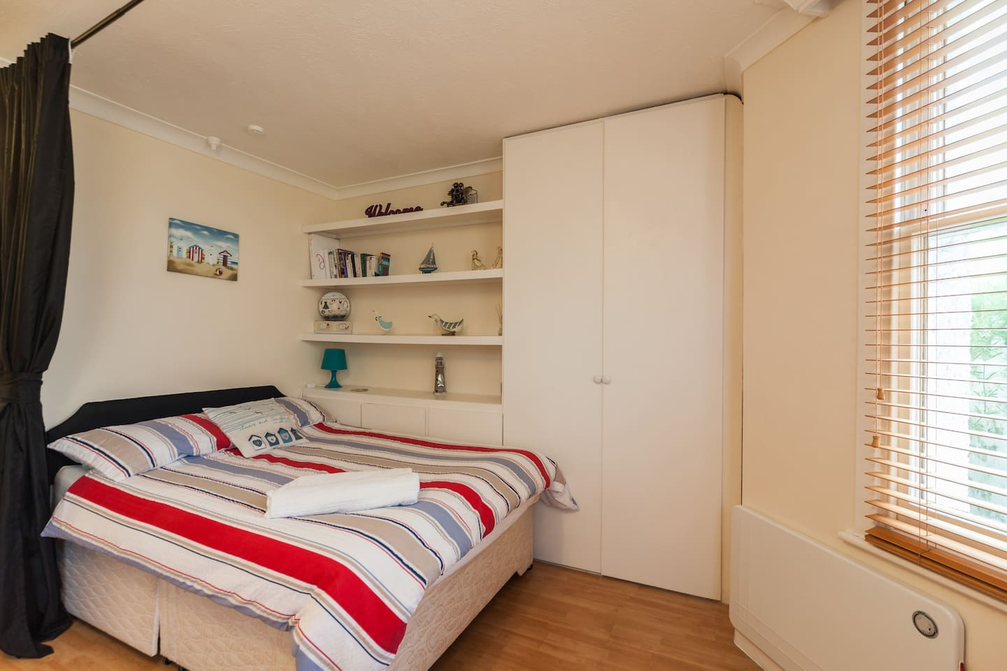 Double Bed Sleeping Area Separated by Curtain for privacy.