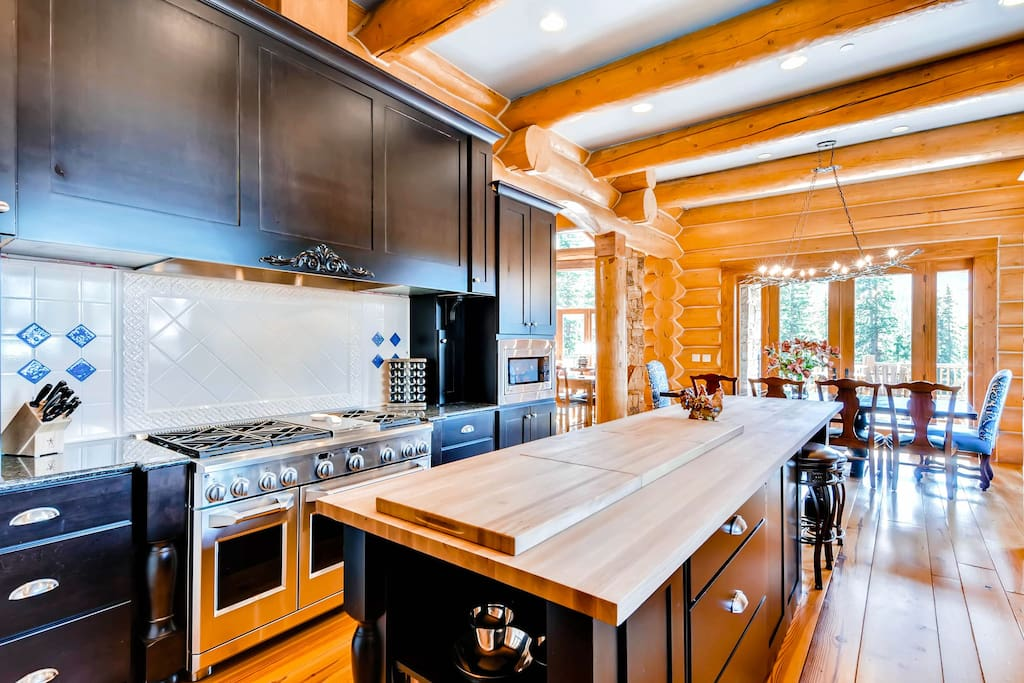featuring six-burner gas stove, two ovens, grantie counter tops and large butcher block island with seating