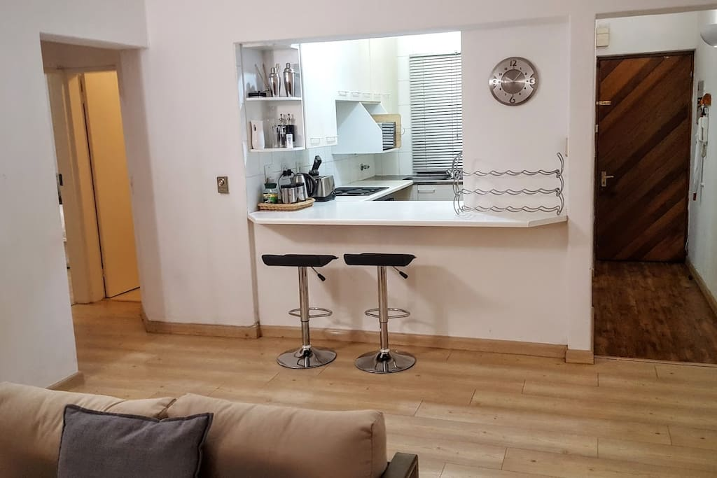 To ensure flow of conversation while dinner is on the go enjoy the open plan kitchen/lounge arrangement