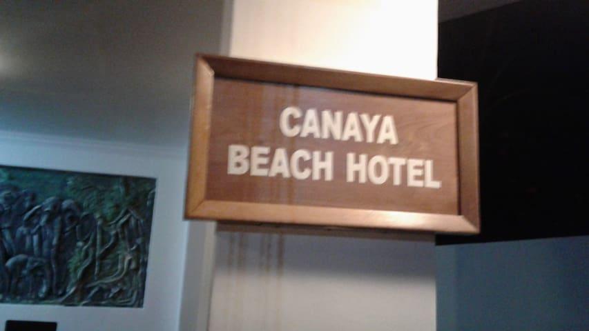 A hotel boardering the beach