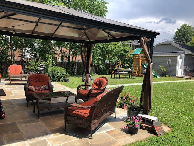 Backyard with soft and comfortable Sofa with tent for shade.