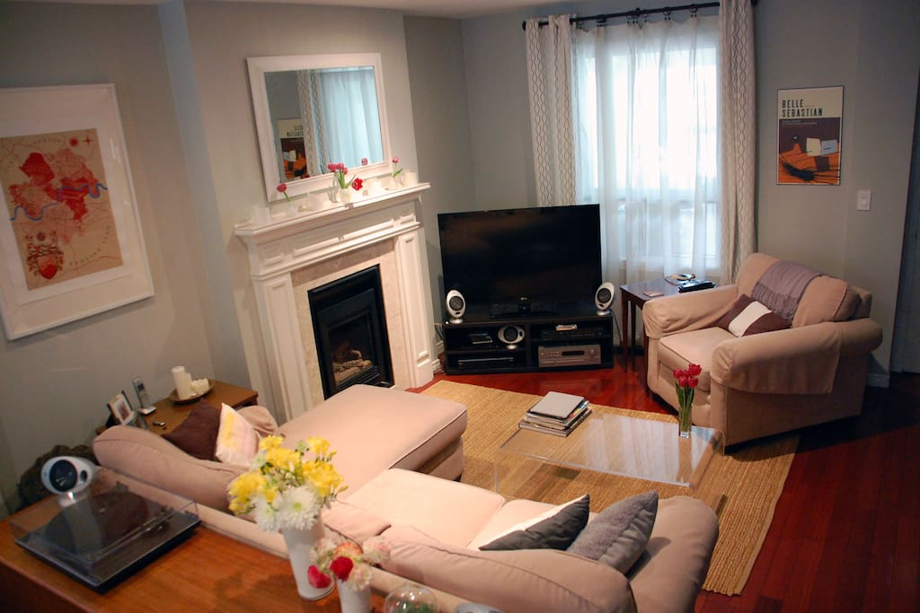 Living room area, with gas fireplace, and HDTV