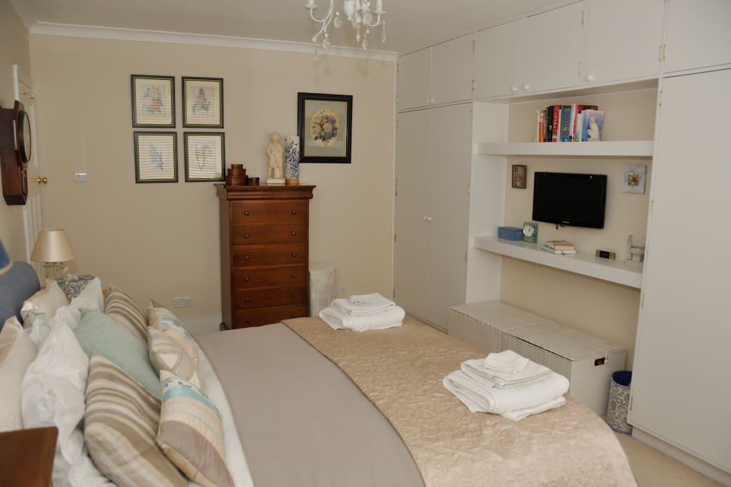 The large and beautifully light bedroom, with your own TV
