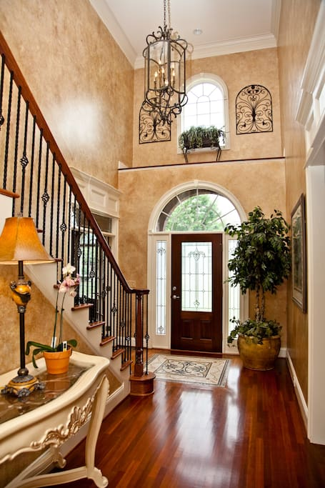 Guests enter this front door and can go straight up the stairs to access their room.