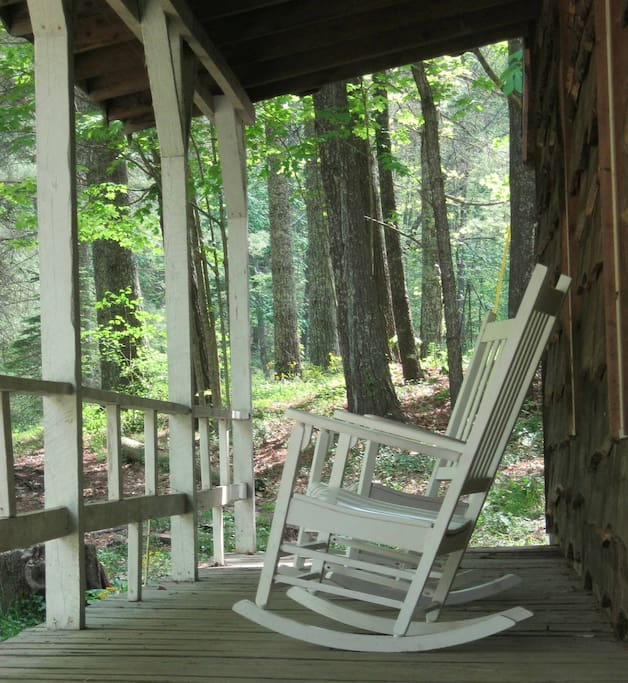 Chipmunk Cabin porch is just above a babbling book.