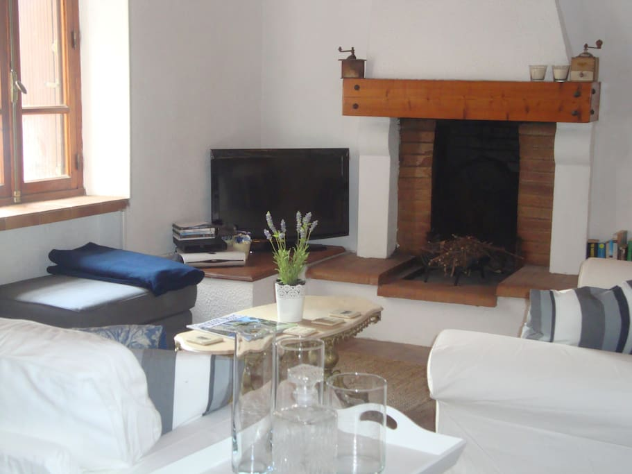 Beautiful large lounge room with open fireplace. Includes tv with cable tv and Wifi.