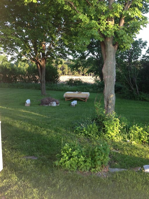 There's a firepit, picnic table, and apple tree in the back!