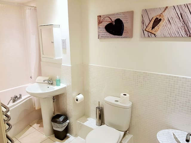 Two bathrooms, one with a bath, one a shower, and a cloakroom too