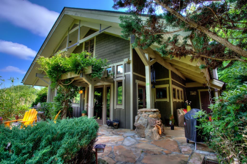 Escape to this mountain paradise home with native stone and timbers, soaring ceilings and walls of windows and panoramic views.
