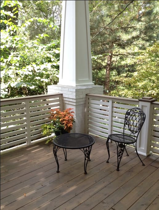 Enjoy this private large deck overlooking back yard garden on a quiet street.