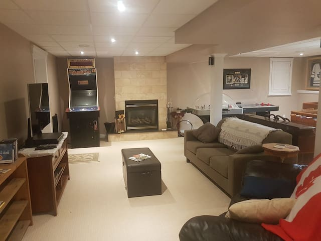 Main area includes a flat screen TV with the 'Best' Bell package and surround system. Double sized pull out couch, gas fire place, and many games.