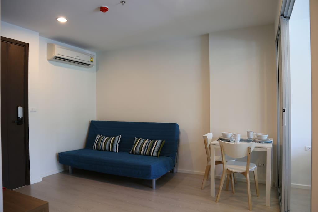 Living and eating area with futon.